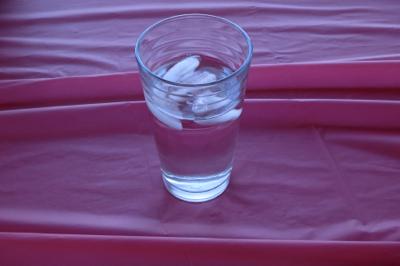 2014-06-01-Waterglassonredtablecloth.jpg