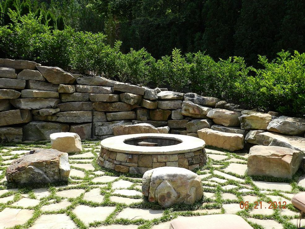 9 ideas that 39 ll convince you to add a fire pit to your for Backyard rock fire pit ideas