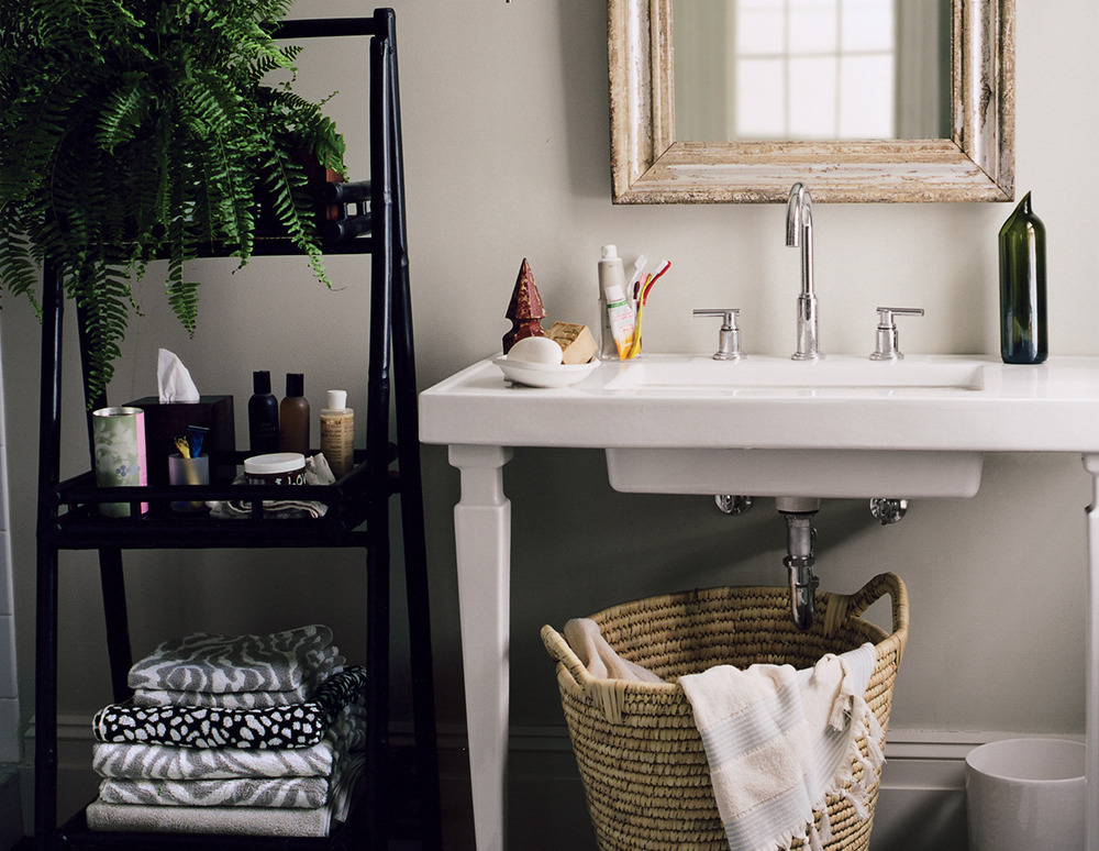 Small Bathroom Hamper 4 ways to make a small bathroom feel huge | huffpost
