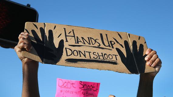 2014-08-18-protestsignoverfergusonshootingdata.jpg