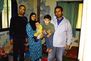 2014-08-21-syrianrefugeefamily.jpg