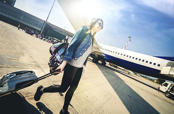 2014-08-26-Cover_YoungWomaninDenimJacketandBlackJeansSmilingandBoardingPlane_580x382.jpg