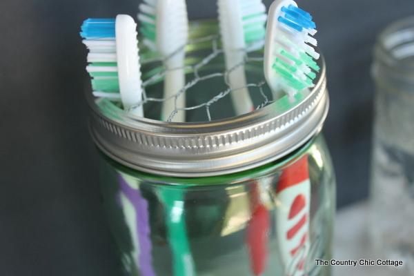 9 amazing tranformations for simple mason jars huffpost for Mason jar holder ideas