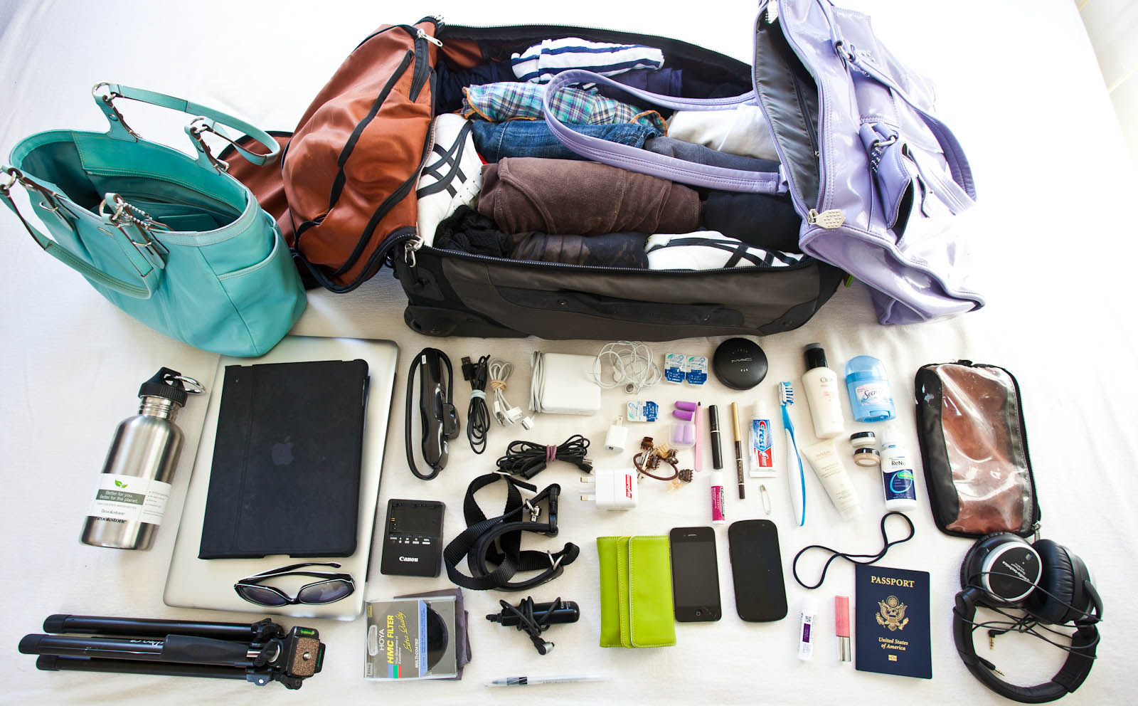 10 tips for traveling light and looking like you didn 39 t How to pack a carry on suitcase video