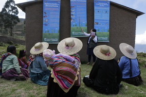 A group of mothers join a health worker at a nutrition education session in Bolivia.