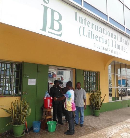2014-09-09-LiberiaBankPrepJarseaBurphy.jpg
