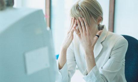 2014-09-11-stressedwomanatwork.jpg