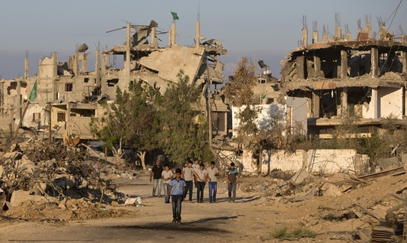 2014-09-16-Photo2_Gaza_Image_Getty_Palestinianboyswalkpastbuildings.jpg