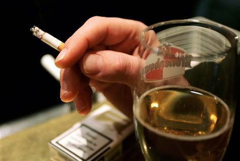 cigarette smoking and alcohol drinking and Extensive research supports the popular observation that 'smokers drink and  drinkers smoke' moreover, the heaviest alcohol consumers are also the heaviest .