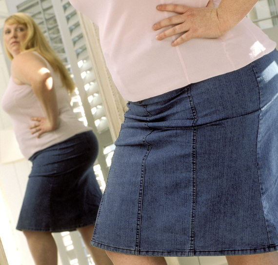 2014-09-18-overweightwomanmirrorcropped.jpg