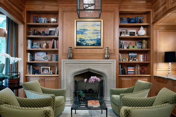9 interior designers illustrate how to decorate with a for Warm inviting colors for living room