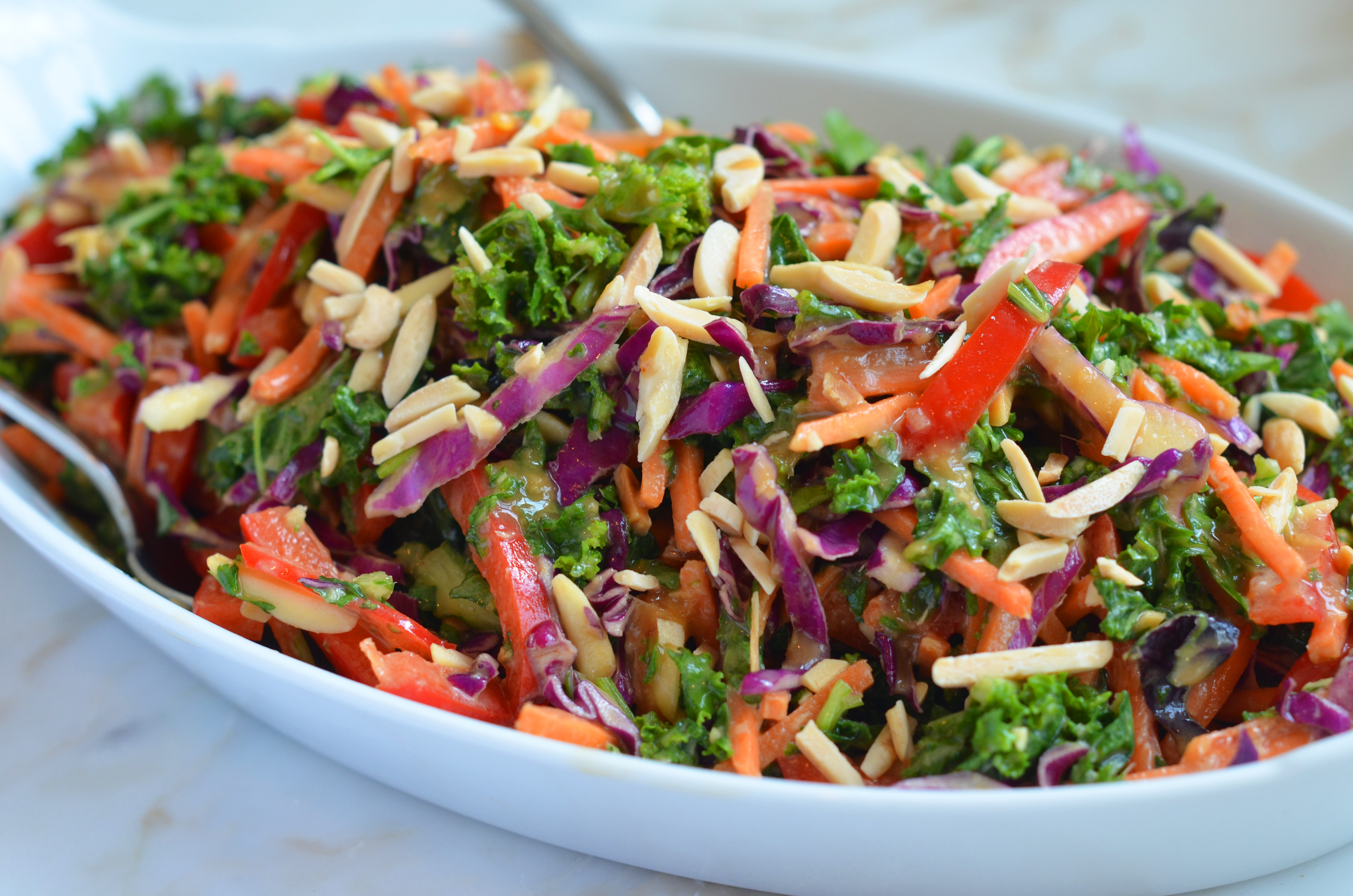 Asian Kale Slaw with Creamy Ginger Peanut Dressing