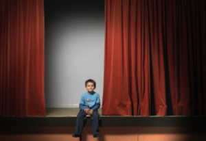 2014-10-22-boy_sits_stage.jpg