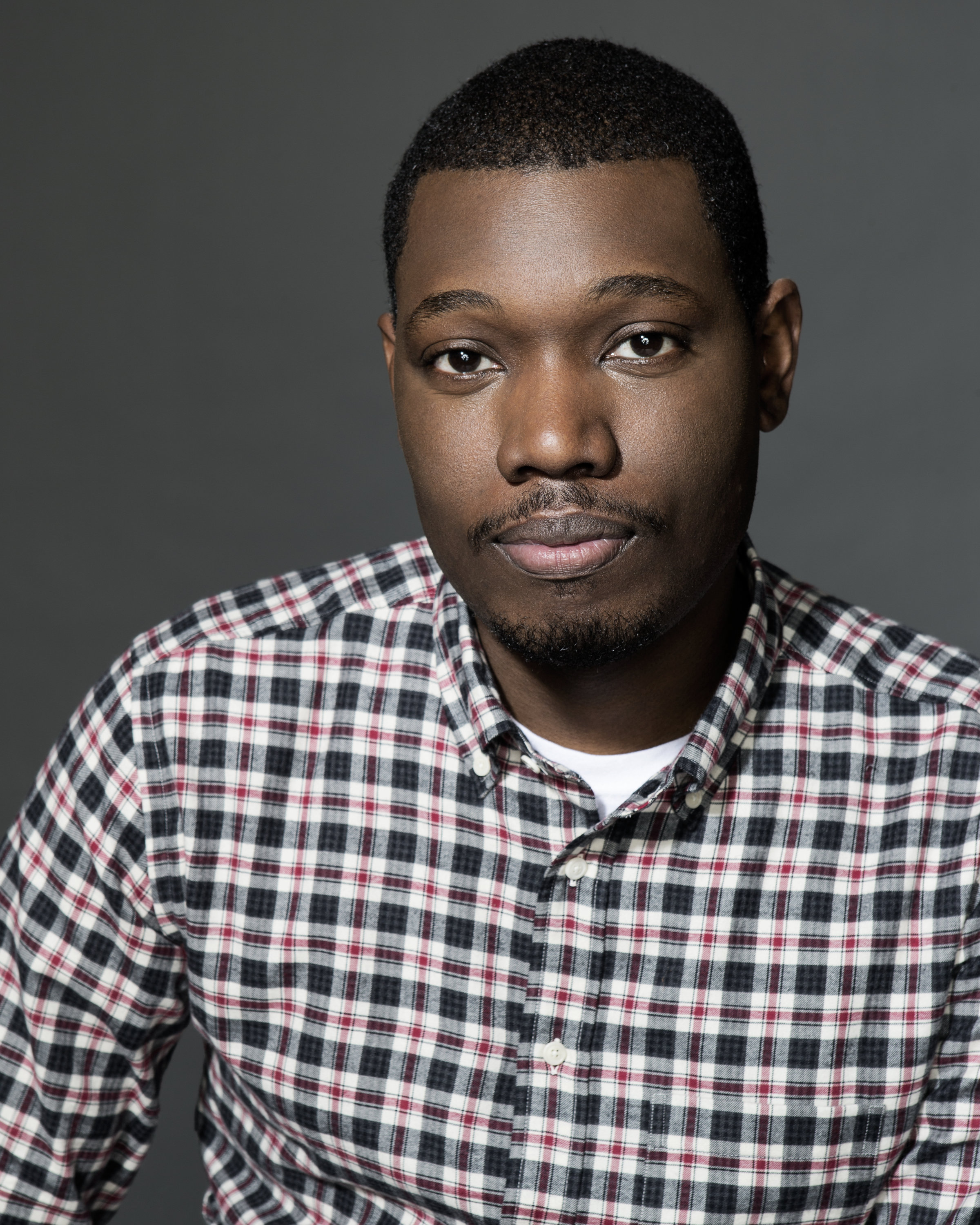 The 34-year old son of father Nathaniel Campbell and mother Rose Campbell, 187 cm tall Michael Che in 2018 photo