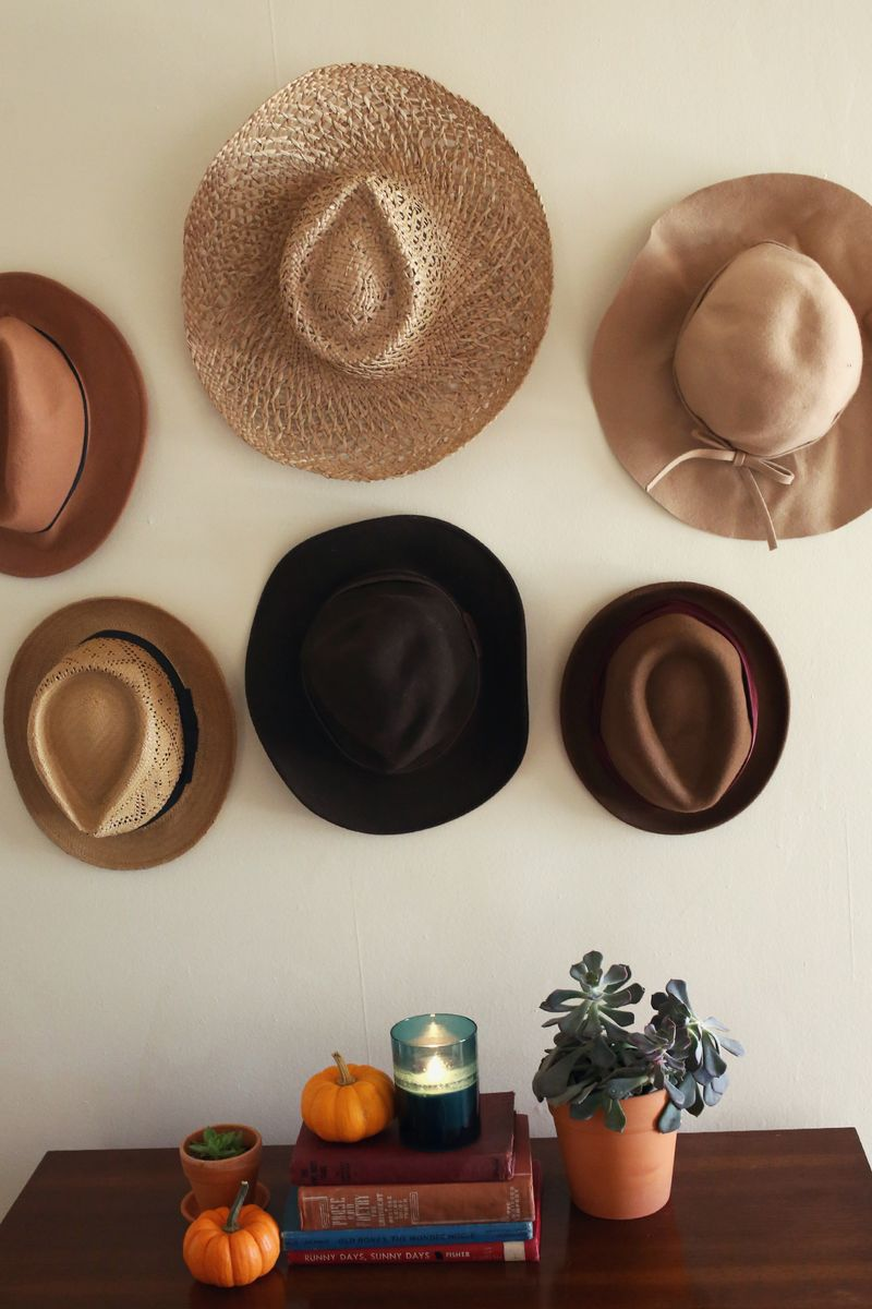 10 easy wall decor ideas huffpost for Hat hanging ideas