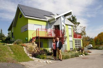 Dave Spencer and Debbie Wiltshire in front of their net-zero home