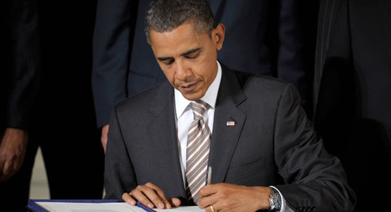 2014-11-21-101204_obama_signing_ap_328.jpg