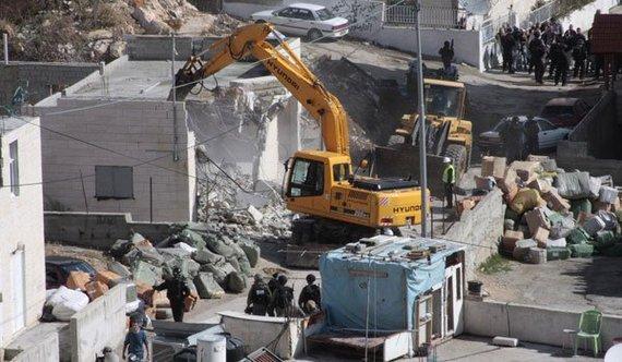 2014-11-24-israelisoldiersstandingguarddemolishingbuildingjerusalem.jpg