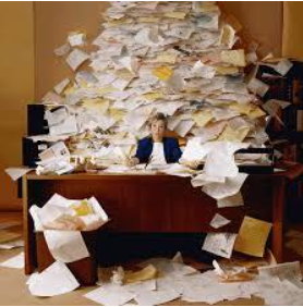 2014-11-25-woman_with_desk_paper_covered.png