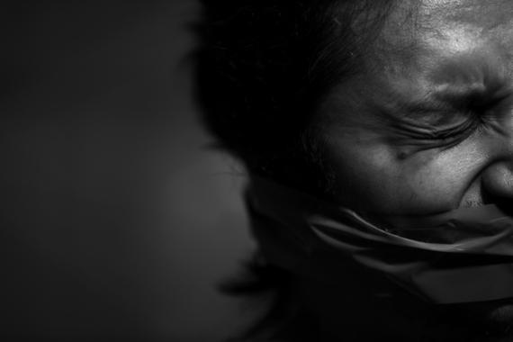 2014-12-09-202285_Illustration_Image__Torture_Philippines.jpg