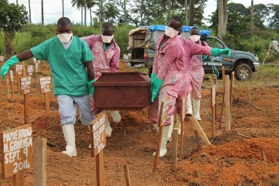 2014-12-29-EbolaburialMSF_570W.jpg