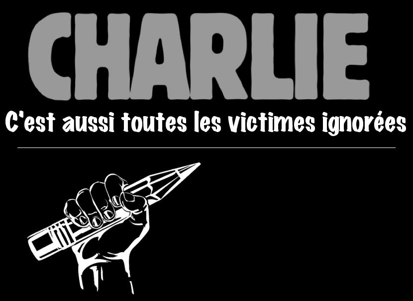 Sur fond noir : CHARLIE, c'est aussi toutes les victimes ignorées.  Dessin emblématique d'une main tenant un crayon levé.