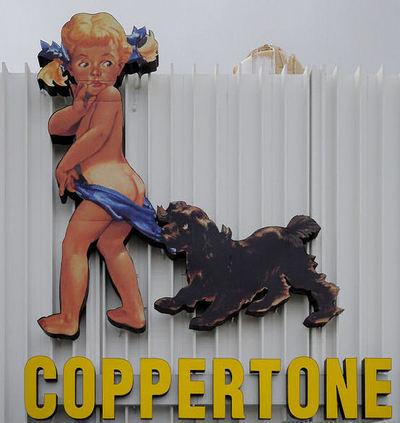2015-02-02-Figure24.2_Coppertone_sign_miami.jpg