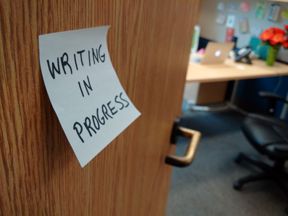 Office door with post-it note - Writing in progress - photo credit Carmi Levy