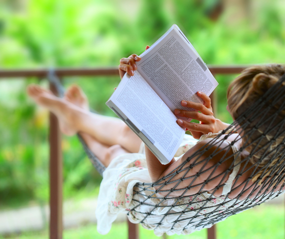 2015-03-03-WomanRelaxinginHammockwithBook.jpg