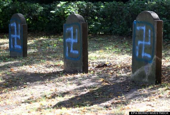 2015-03-04-1425486454-9132540-SwastikasprayedontombstonesattheJewishcemeteryinKroepelinhuffingtonpost.co.uk.jpg