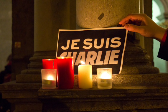 2015-03-15-1426426969-1147028-Cologne_rally_in_support_of_the_victims_of_the_2015_Charlie_Hebdo_shooting_201501072319.jpg