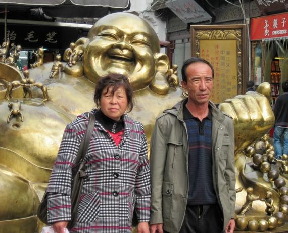 2015-03-16-1426542797-7551453-Chinateacoupleandgoldbuddha.jpg