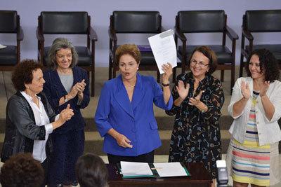 2015-03-17-1426603363-4002926-Brazil_FemicideLaw_RoussefSigns_400x267.jpg