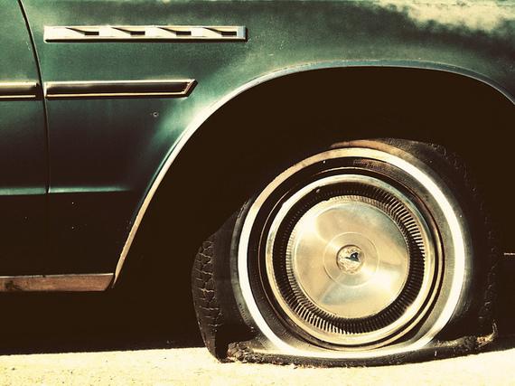 2015-03-18-1426643865-3961805-flat_tire.jpg