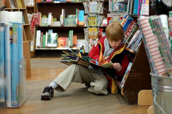 2015-03-22-1427032876-2819745-1024pxChild_reading_at_Brookline_Booksmith.jpg