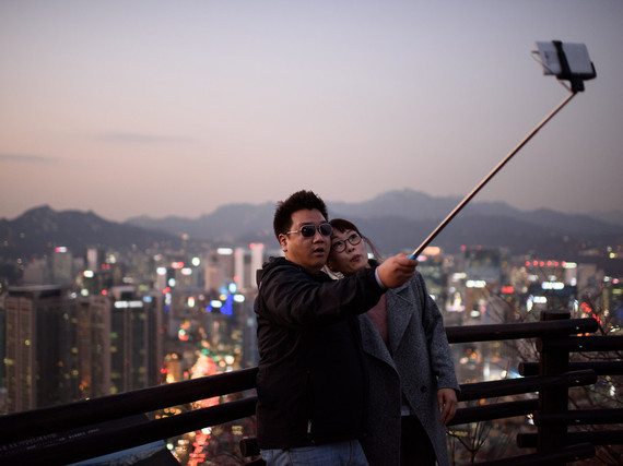 2015-03-23-1427143142-7315218-2547cbed22a3d21fa285cb6b1_selfiestickseoulsouthkorea.jpg
