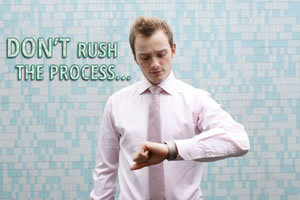 Don't Rush the Process... man looking at watch and his aim is a solid post-divorce credit score and financial life.