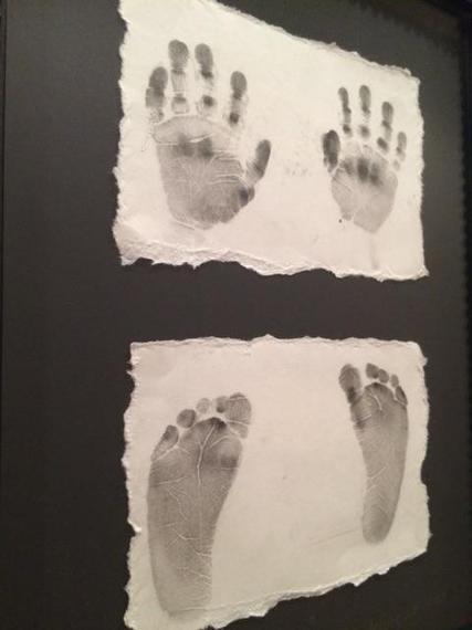 2015-04-02-1427989362-2029524-Madelinehandfootprints.jpg