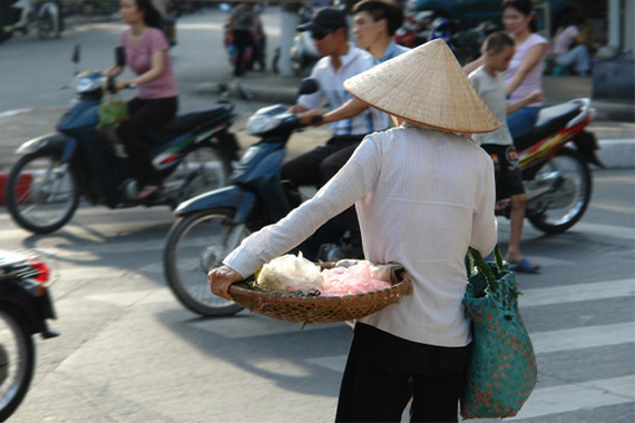 2015-04-15-1429123365-7479950-vietnamstreet_vendor_waiting_to_cross_busy_streetdd.jpg