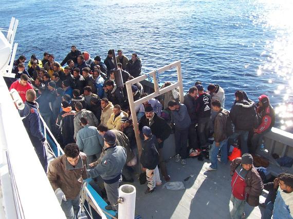 2015-04-16-1429228276-9358390-Boat_People_at_Sicily_in_the_Mediterranean_Sea.jpg