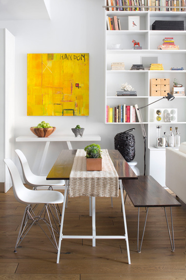 Midcentury modern dining nook with White Eames Chairs by Decor Aid