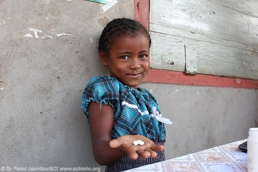 A girl in Madagascar shows the deworming tablets provided to her by the Schistosomiasis Control Initiative, one of the most effective charities in the world