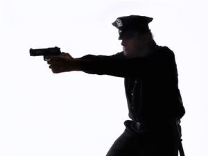 2015-05-23-1432400772-1737308-Police_shooting.jpg