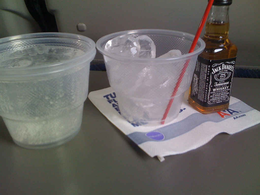 how to feel less nauseaous on a plane