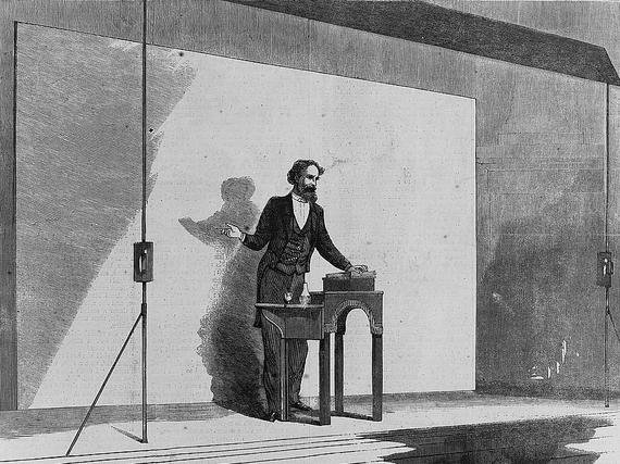 2015-06-12-1434124097-1883367-Charles_Dickens_public_reading_1867.jpg