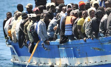 2015-06-17-1434563790-5249954-LampedusamigrationTheGuardian.jpg