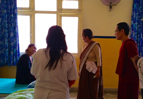 2015-06-17-1434576160-8914270-Rinpoche_clinic_visit.jpg