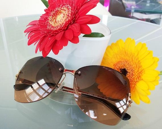 2015-06-18-1434617548-421479-sunnieswithflowers.jpg