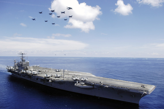 2015-06-26-1435308304-7712626-US_Navy_060508N4166B030_The_Nimitzclass_aircraft_carrier_USS_Abraham_Lincoln_CVN_72_and_aircraft_assigned_to_Carrier_Air_Wing_Two_CVW2_perform_an_aerial_demonstration_in_the_South_China_Sea.jpg