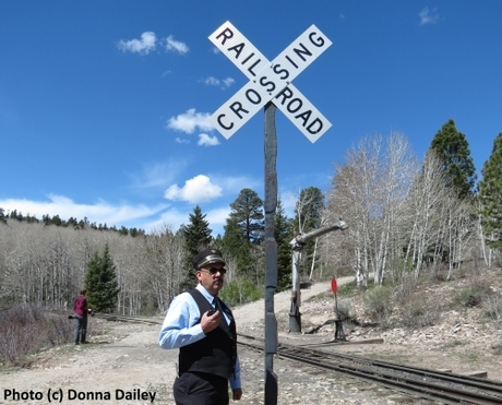 2015-06-30-1435707681-7789934-Cumbres_Toltec_Scenic_Railroad_9_conductor_Ray_Martinez_and_Railroad_Crossing_sign.jpg
